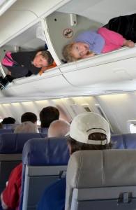 Kids in plane overhead bins