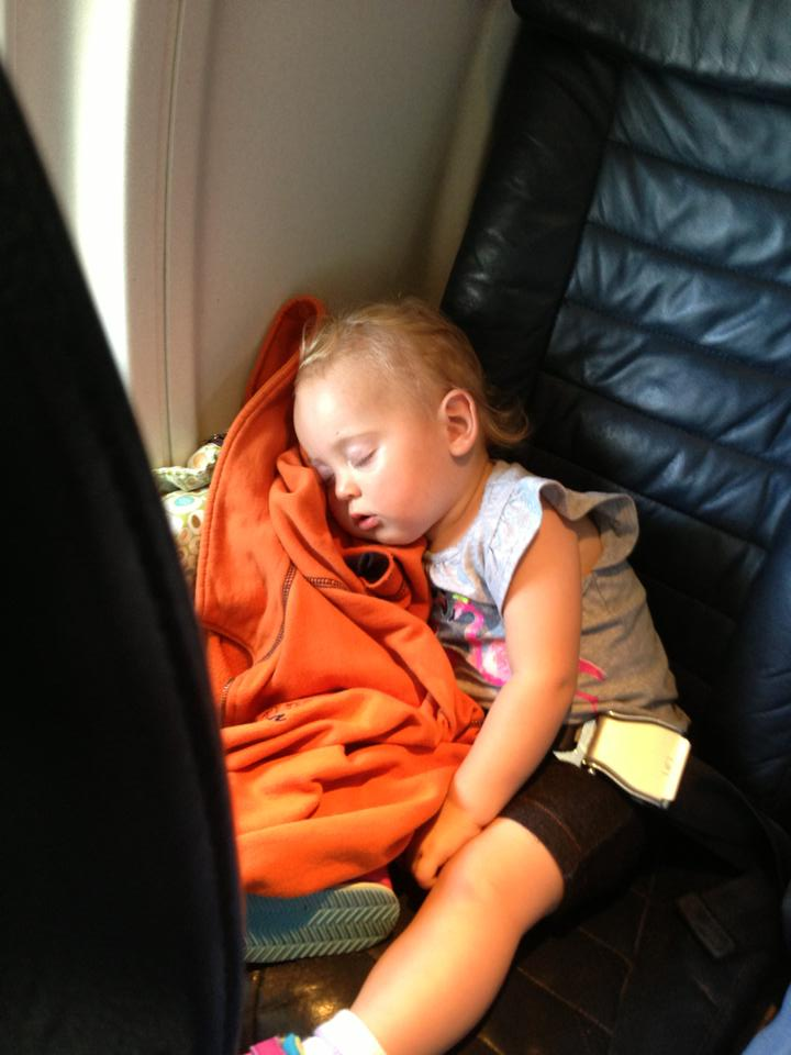 Isla sleeping on the plane