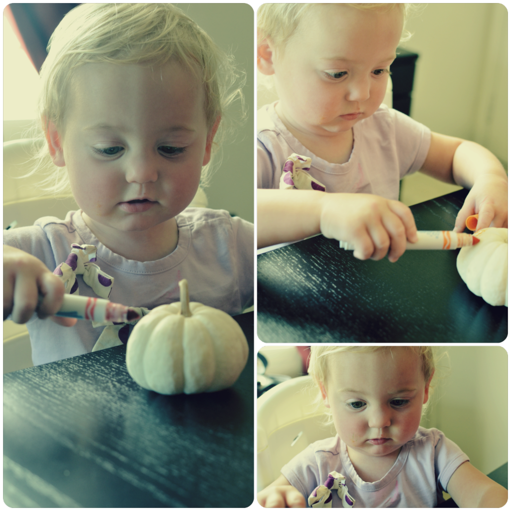Isla decorating pumpkins