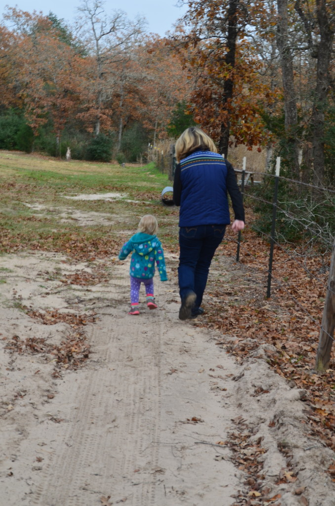 Isla and Grammy running around on the farm