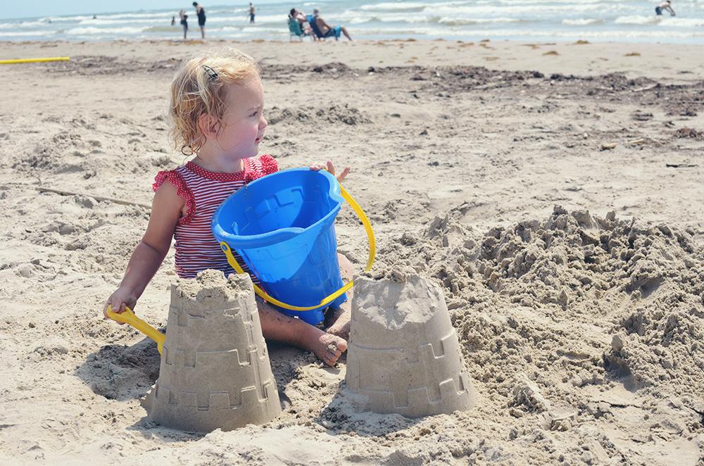 Isla building sandcastles