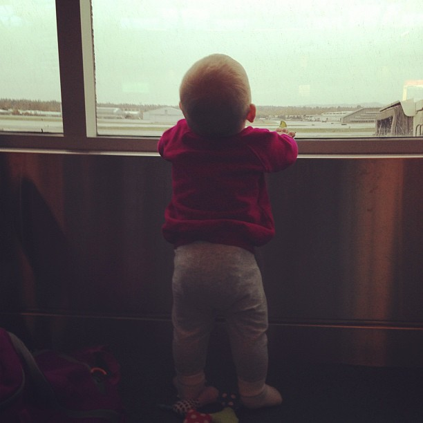 Isla watching the planes taking off in 2012.