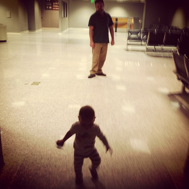 Isla running through the Austin airport in 2013