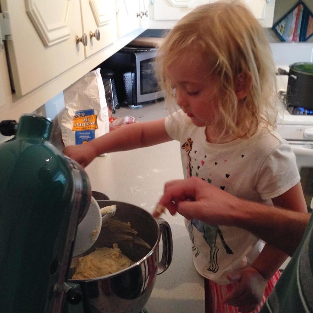 Helping make noodles
