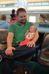 Happier moments from Isla's travels: at the gate
