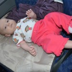 Happier moments from Isla's travels: playtime with parents