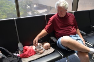 Happier moments from Isla's travels: baggage claim with Grandpa