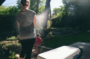Watering the plants/toddler