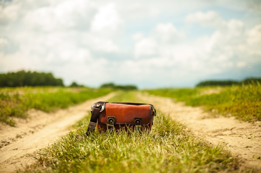 Bag abandoned on a dirt road